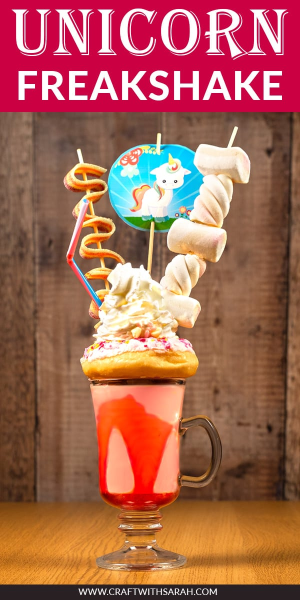 Slurrrrrrp! Who's up for a unicorn freakshake recipe? Enjoy this unicorn milkshake with tasty strawberry flavor, pink sprinkle donut, whipped cream, marshmallows, unicorn bacon and sprinkles. All finished off with a super cute printable unicorn cupcake topper. This unicorn milkshake recipe is perfect for unicorn lovers . The ultimate unicorn freakshake DIY! #freakshake #milkshake #unicorn #unicornrecipe