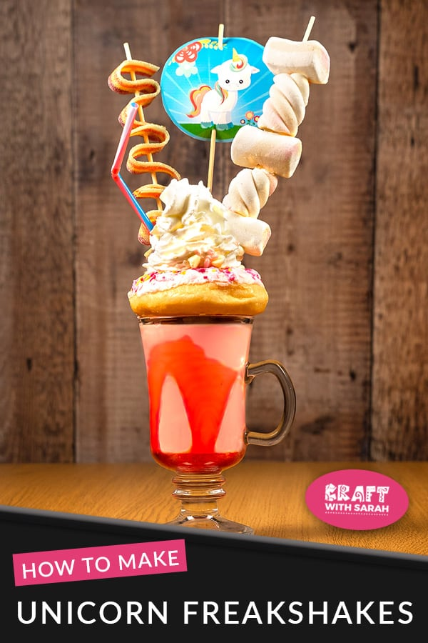 Indulge your sugar cravings with this unicorn freakshake: a strawberry, doughut, cream & sweet filled unicorn milkshake. It's got to be one of the best unicorn milkshakes that I've tried. The post contains free printable toppers to decorate your freak shake and use in other craft projects. #unicorn #unicornparty #unicornrecipes