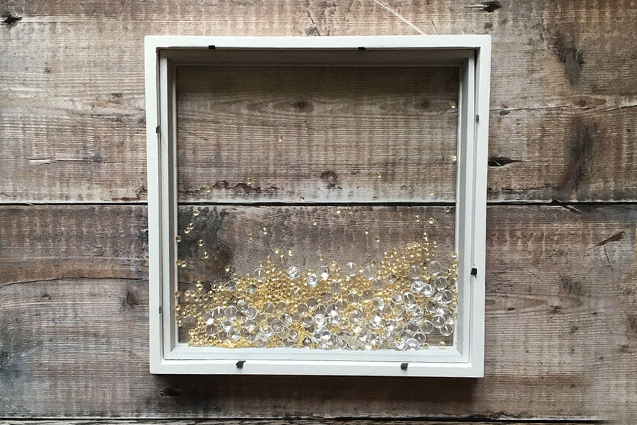Gemstones inside box frame