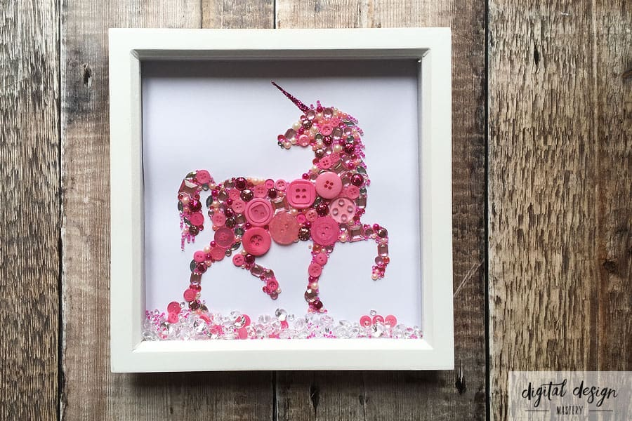 Completed unicorn button art framed in white box frame