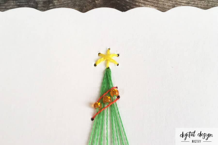 Card stitching instructions: Stitching the star on top of the Christmas tree