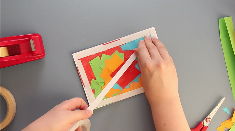 Add double sided tape to each of the edges, and down the middle