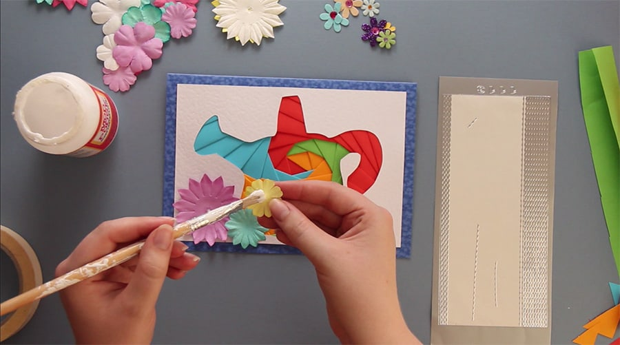 Add paper flowers to embellish your iris folding greetings card