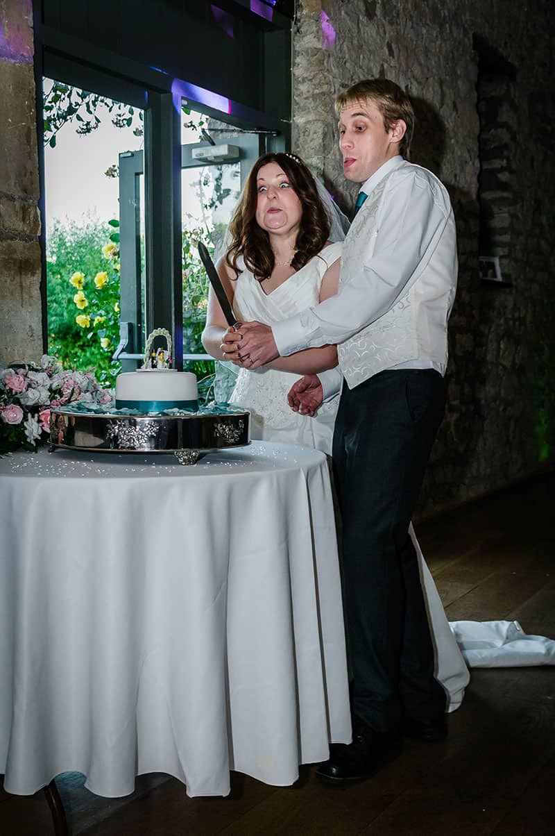 Cutting the wedding cake - funny cake cutting photo