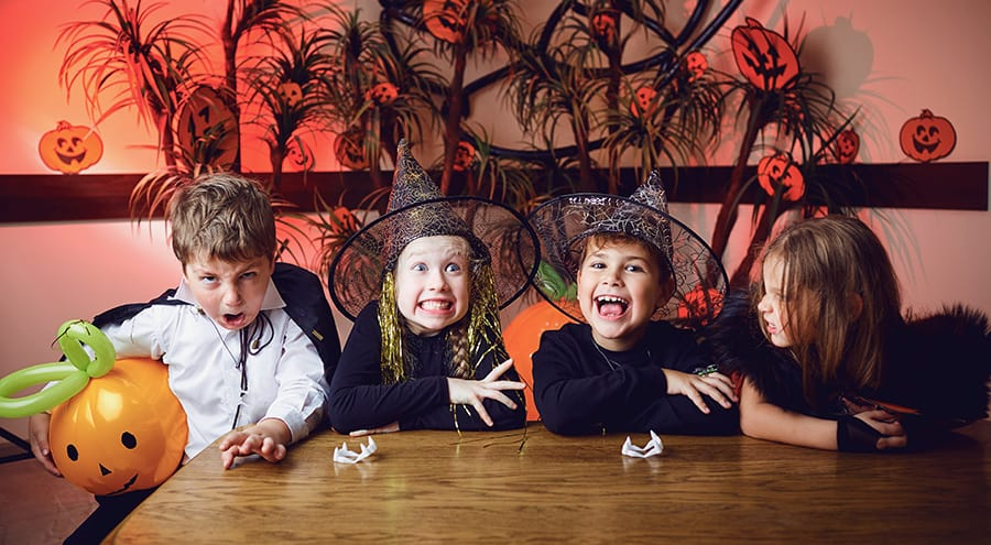 Kids in Halloween costumes having fun at a party