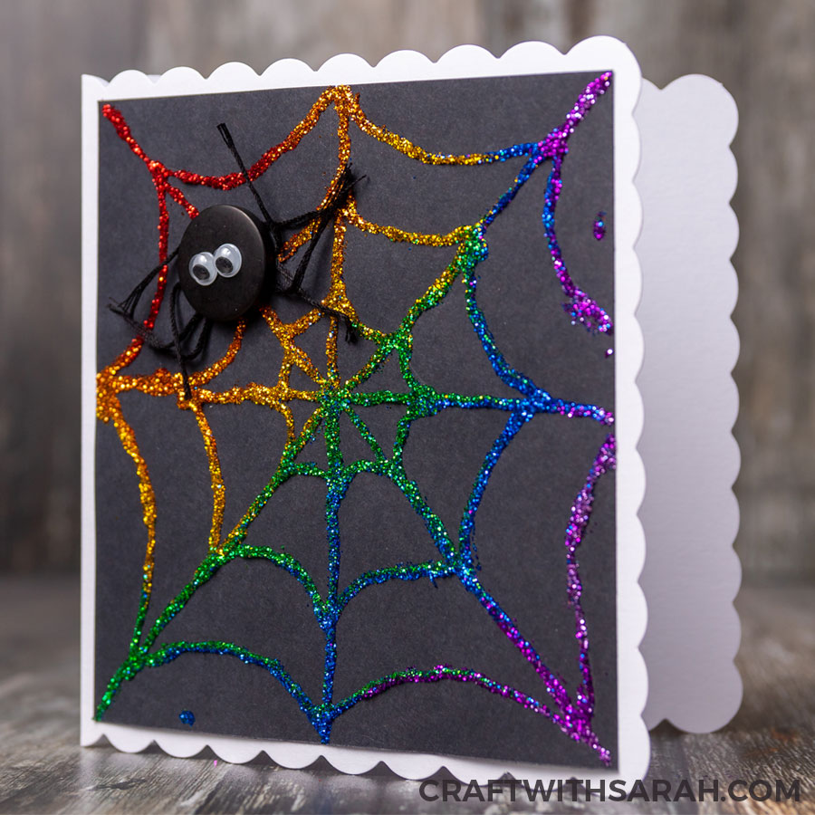 Handmade greetings card of a glittered spider web for Halloween