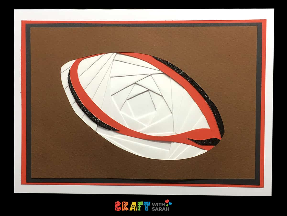 An iris folding pattern of a rugby ball or American football.  This would be a great pattern for Father's Day or for a birthday card for your rugby loving friend!