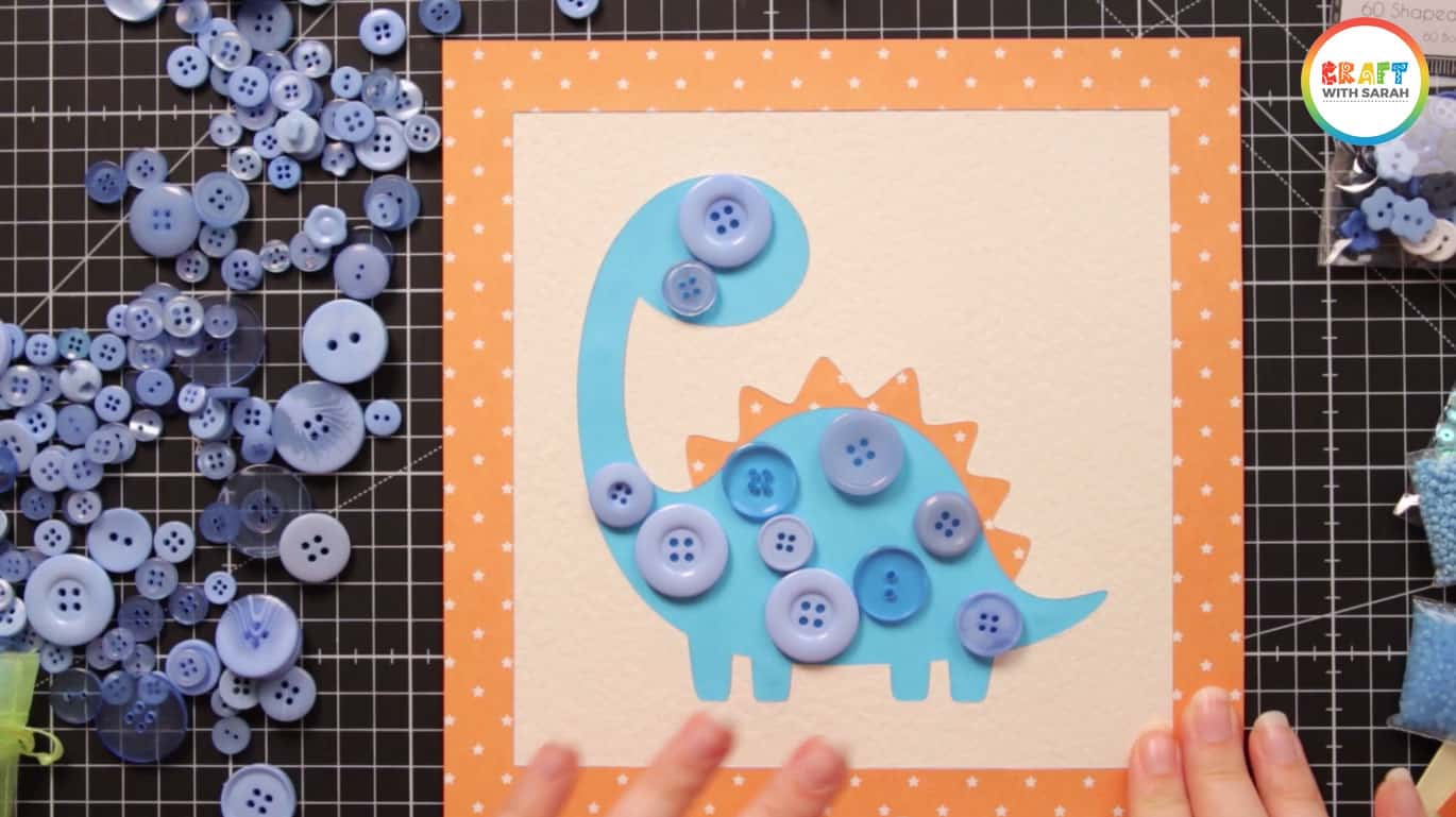 Large buttons on dinosaur button art