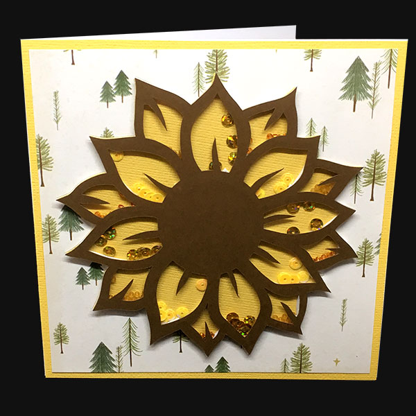Love shaker cards? Try this out! Tutorial for making complex shaker cards with your Cricut. Every petal on the sunflower is a different shaker section, so you can be REALLY creative with your embellishment choices. A lovely sunflower greetings card tutorial.