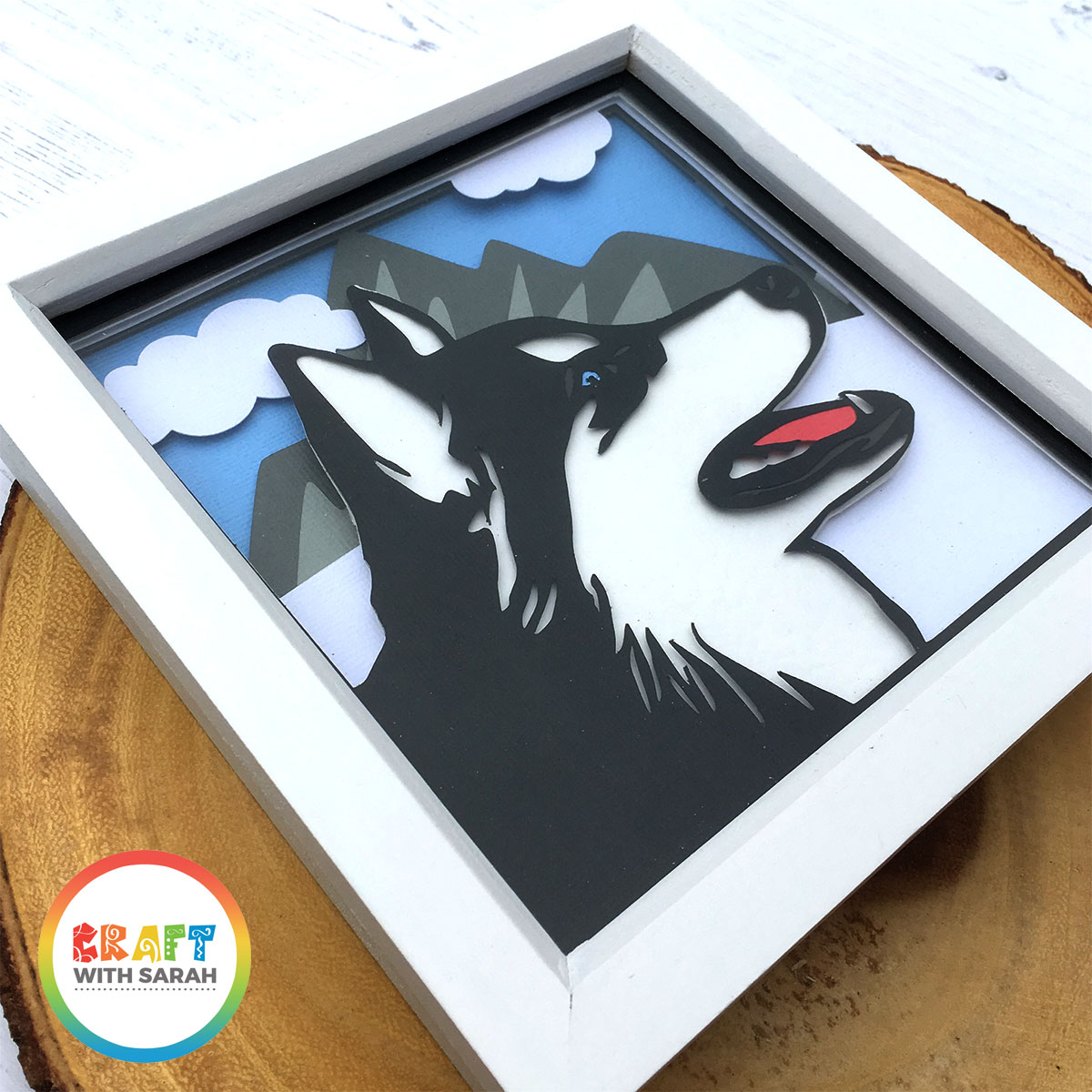 Free SVG cutting file of a husky dog in the snow with mountains