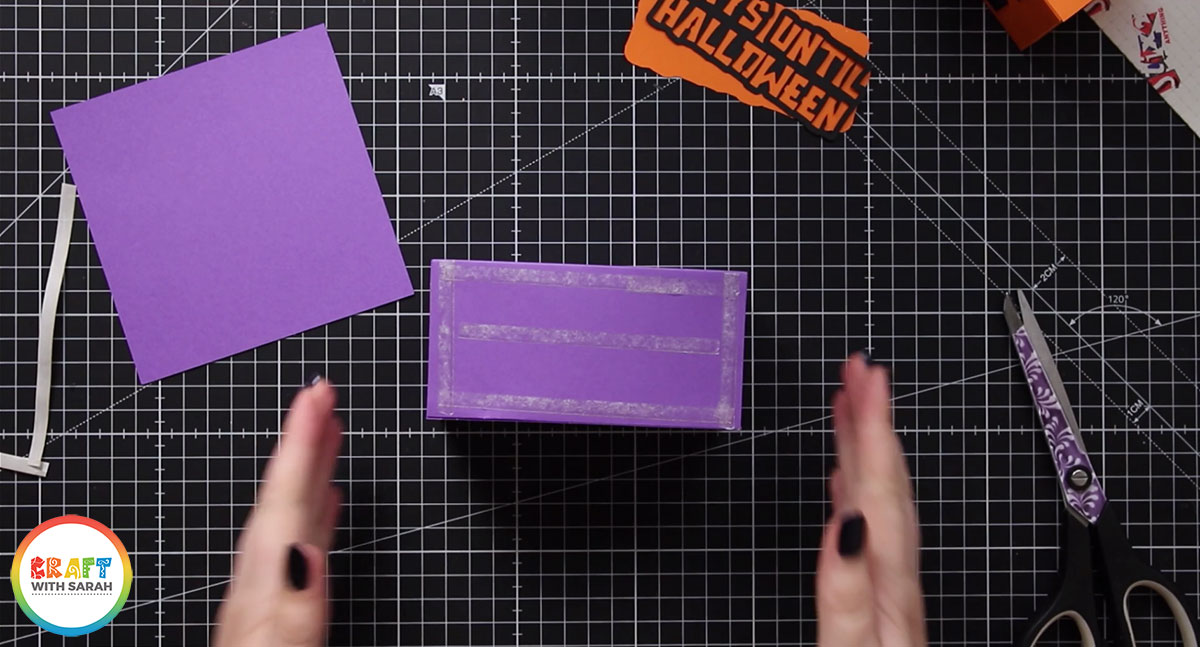 Add double sided tape to the back of the purple box