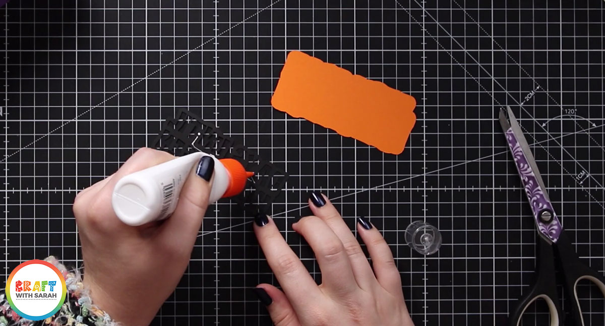 Glue the Happy Halloween sentiment to the orange shadow layer