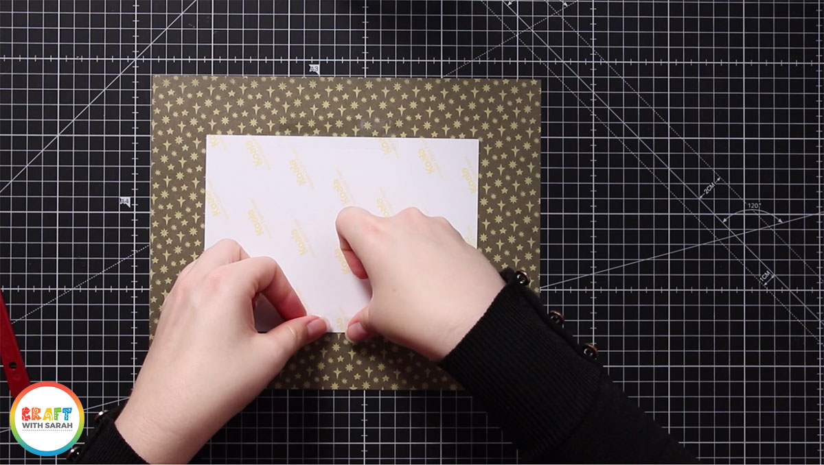 Stick your artwork to the back of the mat with sticky tape