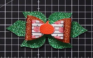 Add the pumpkin in the middle of the hair bow