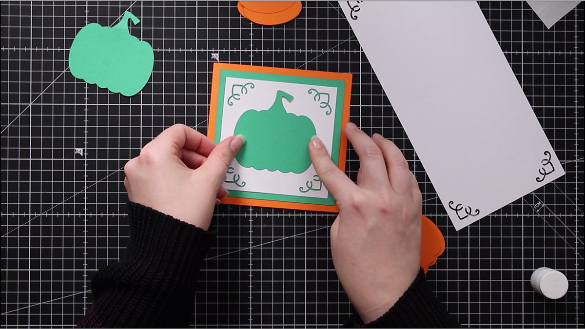 Glue the green pumpkin WITHOUT a score line to the front of your card