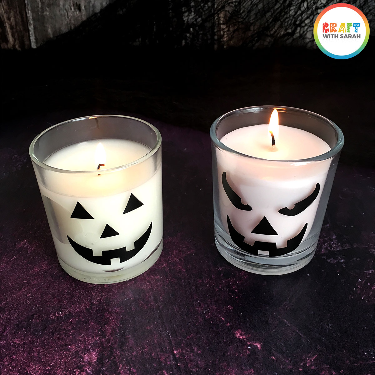 Pumpkin faces added to candles