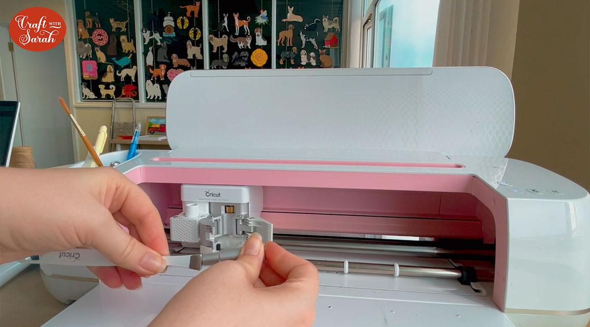 Remove the Cricut blade with tweezers