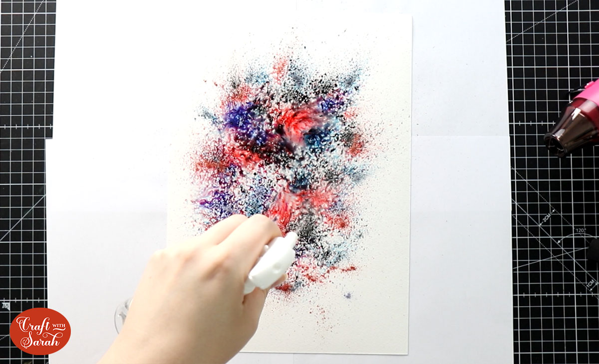 Spray water onto the paper