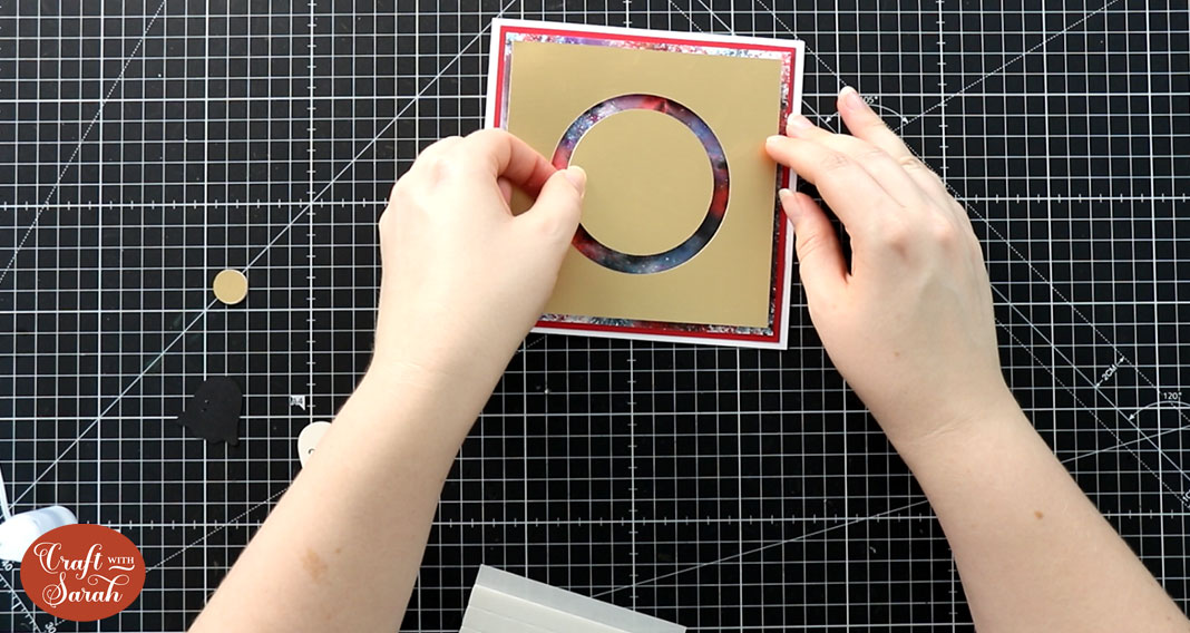 Stick the circle piece of card in the middle